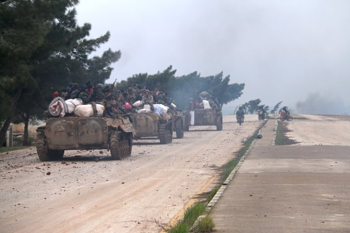 Syrian soldiers are seen on the Damascus-Aleppo highway near the administrative border of Aleppo province, Syria, on Feb. 12, 2020. For the first time since 2012, the Syrian army wrested control of the strategic Damascus-Aleppo highway following battles against the rebel groups, a war monitor reported on Tuesday. (Str/Xinhua)