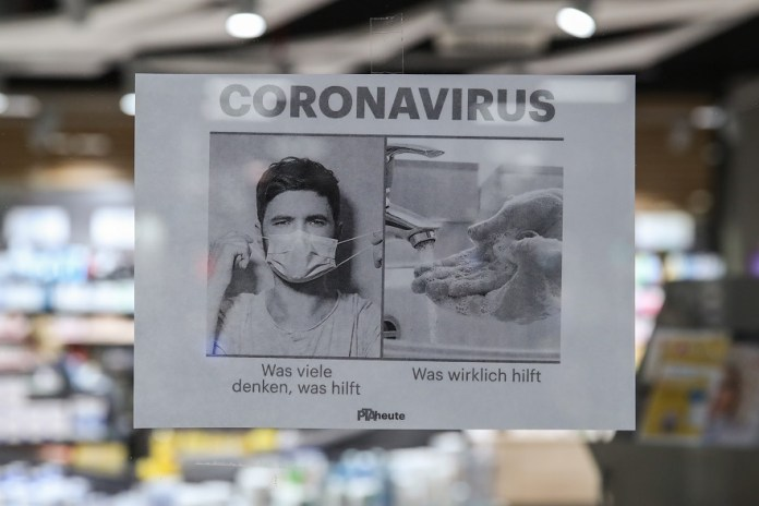 A poster calling on more hand washing instead of purchasing masks is seen at a pharmacy in Berlin, capital of Germany, March 3, 2020. Germany's confirmed cases of COVID-19 have increased to 188 on Tuesday from 150 a day earlier, according to Robert Koch Institute (RKI), a federal government agency and research institute responsible for disease control and prevention. (Xinhua/Shan Yuqi)
