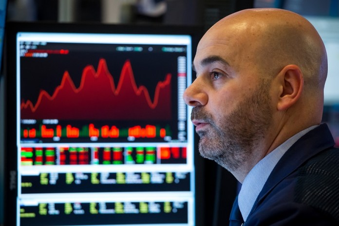 A trader works at New York Stock Exchange in New York, the United States, on March 3, 2020. U.S. stocks fell sharply in volatile trading on Tuesday despite the Federal Reserve's emergency interest-rate cut. The Dow Jones Industrial Average dropped 785.91 points, or 2.94 percent, to 25,917.41. The S&P 500 went down 86.86 points, or 2.81 percent, to 3,003.37. The Nasdaq Composite Index fell 268.07 points, or 2.99 percent, to 8,684.09. (Photo by Michael Nagle/Xinhua)