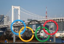 The Olympic rings are seen in front of Tokyo's iconic Rainbow Bridge and Tokyo Tower at Odaiba Marine Park on January 20, 2020 in Tokyo, Japan. (Photo by Clive Rose/Getty Images)