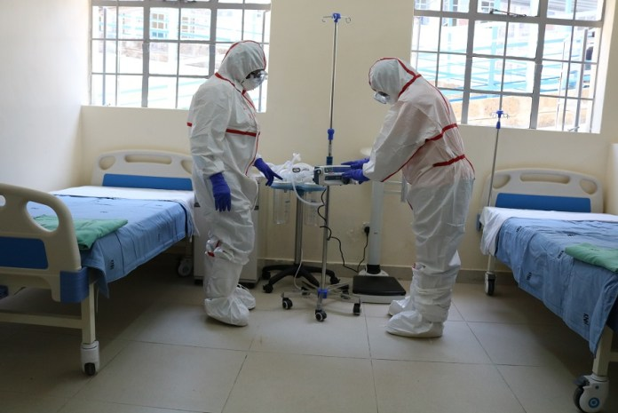 Medics work at the coronavirus isolation centre at the Mbagathi Hospital in Nairobi, Kenya, March 6, 2020. (Photo by Fred Mutune/Xinhua)
