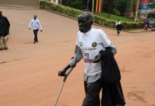 An elderly man participates in the anti-corruption walk in Kampala, capital of Uganda, Dec. 4, 2019. Ugandan President Yoweri Museveni on Wednesday led an anti-corruption walk in the capital city of the East African country. (Xinhua/Nicholas Kajoba)