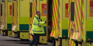 NHS Ambulance staff outside the ExCel Center in London, Britain in, 29 March 2020. The Excel Center is to be used as a makeshift hospital from next week. According to news reports the NHS is anticipating a Coronavirus 'tsunami' as the peak of infarction rates nears. British Prime Minister Boris Johnson has announced that Britons can only leave their homes for essential reasons or may be fined, in order to reduce the spread of the Coronavirus. EPA/WILL OLIVER