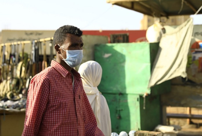 A Sudanese man is seen wearing a face mask in Khartoum, Sudan, on March 14, 2020. Sudan's Health Ministry on Friday announced the death of a Sudanese citizen infected with COVID-19. (Photo by Mohamed Khidir/Xinhua)