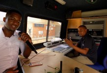 Radio presenters from the Namibia Broadcasting Corporation (NBC) go about their work in an Outside Broadcasting (OB) van in Windhoek, capital of Namibia, Feb. 13, 2020. Namibia on Thursday joined the rest of the world to celebrate the 9th edition of World Radio Day. (Xinhua/Musa C Kaseke)