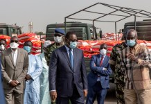 Senegalese president Macky Sall (C) inspects the cargos of food for families affected by COVID-19 at the Dakar Autonomous Port in Dakar, Senegal, April 11, 2020. Senegalese President Macky Sall launched Saturday a food delivery operation in the regions at the Dakar Autonomous Port as part of assistance to households affected by COVID-19. Sall initiated the emergency food aid program with a budget of 69 billion Francs CFA (about 114 million U.S. dollars), which is drawn from the response and solidarity fund against the effects of COVID-19 for the purchase of 146,000 tonnes of food to distribute to targeted households across the country. (Photo by Eddy Peters/Xinhua)