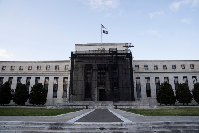 Photo taken on March 15, 2020 shows the U.S. Federal Reserve building in Washington D.C., the United States. The U.S. Federal Reserve on Sunday cut its benchmark interest rate by a full percentage point to near zero and will increase its bond holdings by at least 700 billion U.S. dollars amid mounting fears over the COVID-19 outbreak. (Xinhua/Liu Jie)