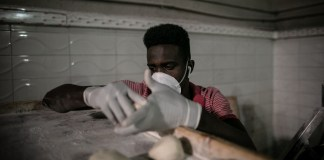 A baker prepares bread dough in a bakery in Tripoli, Libya, on March 16, 2020. The UN-backed Libyan Prime Minister Fayez Serraj on March 14 declared the state of emergency over the possible coronavirus outbreak in the country. Confirming that no coronavirus infections have been detected in the country so far, Serraj said his government is committed to applying the World Health Organization's Strategic Preparedness and Response Plan against the virus. (Photo by Amru Salahuddien/Xinhua)