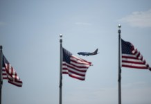 "A plane flies in the sky with the U.S. national flags in the foreground in Washington, D.C., the United States, on July 21, 2020. U.S. President Donald Trump said Tuesday afternoon that the coronavirus pandemic in the United States will probably ""get worse before it gets better."" More than 3.8 million people in the United States have infected with the virus, with more than 141,000 deaths, according to a count by Johns Hopkins University, as some states, including Florida, are seeing a surge in cases. (Xinhua/Liu Jie)"
