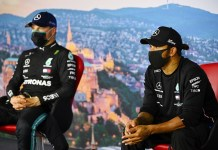 Formula One F1 - Hungarian Grand Prix - Hungaroring, Budapest, Hungary - July 18, 2020 Mercedes' Lewis Hamilton and Valtteri Bottas wear face masks during the post qualifying press conference FIA/Handout via REUTERS ATTENTION EDITORS - THIS IMAGE HAS BEEN SUPPLIED BY A THIRD PARTY. NO RESALES. NO ARCHIVES