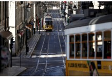 Trams move on tracks along the street, as the spread of the coronavirus disease (COVID-19) continues, in Lisbon, Portugal March 24, 2020. REUTERS/Rafael Marchante