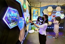 Visitors explore an exhibition with AI technology on July 8 in Shanghai, East China. Photo by Yang Jianzheng/People's Daily Online
