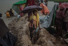 Rohingya Mother And Child Fleeing Myanmar In Oct Photo Muse Mohammed Iom