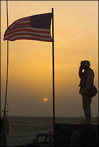 US soldier salutes flag at unspecified location in Middle East (Picture: US Central Command)