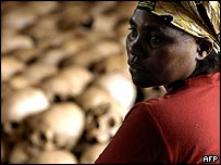 Genocide memorial site guardian Danielle Nyirabazungu next to skulls of genocide victims