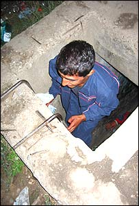 Romanian street child entering his underground home