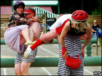 Men bearing their 'wives' in the carrying contest