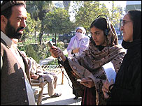 Female Afghan journalist conducts interview