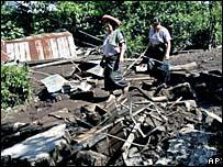 Mayan Indians walk through the mud in Panabaj, Guatemala