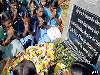 Indian survivors orphaned by the December offer prayers at a tsunami remembrance monument in Nagapattinam