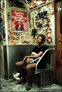 Girl on graffiti-covered New York subway train, Lexington Avenue, 1983