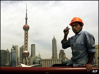 Construction worker and Shanghai skyline