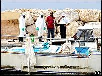 Investigators searching the boat in Bridgetown