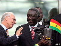 Ghana's President John Kufuor with Fifa's Franz Beckenbauer watching Ghana play Italy