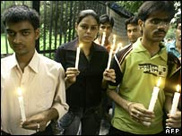 Indians hold candles in Delhi