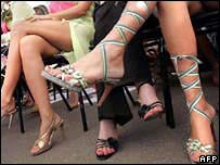 Three women wearing high-heeled shoes