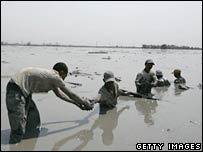 People try to rescue valuable items from the flooded area