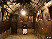 Nun inside the grotto marking the reputed site of Christ's birth