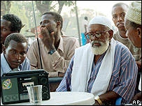 Coffee shop patrons listen to the news in Baidoa