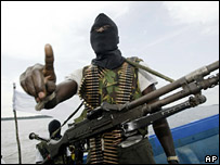 A masked militant holding a gun in the Niger Delta (file image)