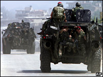 Lebanese troops on an armoured personnel carrier in Tripoli on 20 May 2007