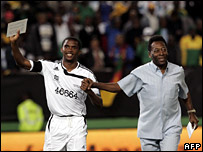 Cameroon's Samuel Eto'o and Brazil's Pele take to the field at Newlands