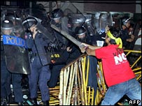 An anti-coup protester clashes with police in the Thai capital Bangkok
