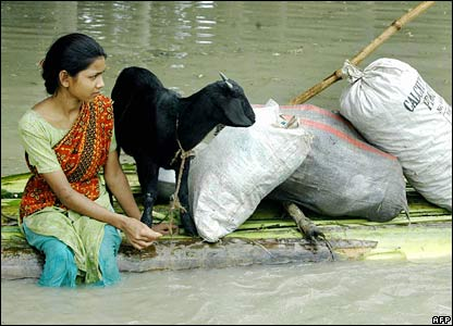 Woman on a boat made of banana leaves