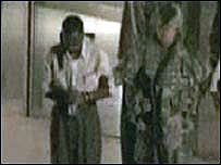 Detail from AP TV footage showing US troops detaining a group of people