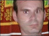 Image of suspect shown on Interpol website (www.interpol.int)