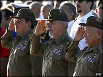 Raul Castro (left) and other veteran revolutionaries at the ceremony in Santa Clara
