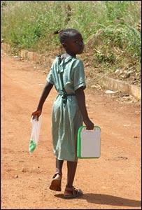 Girl walking with XO laptop