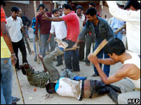 Tribals being beaten in Assam