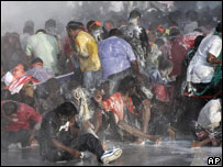 Protestors drenched by water cannon