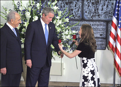 A young girl hands a rose to President Bush as he arrives for a meeting with Israeli President Shimon Peres in Jerusalem on Wednesday, 9 January 2008
