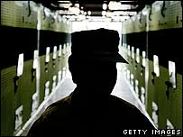 Member of US military in cell block of Guantanamo Bay prison camp