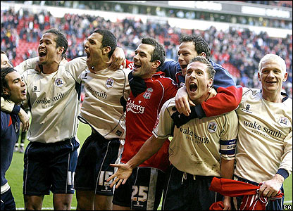 Barnsley players celebrate their victory at Anfield
