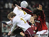 Arsenal's players battle for possession at the San Siro