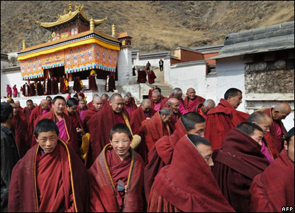 Tibetan Buddhist monks leave a ceremony at the historic Labrang Monastery