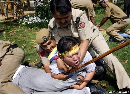 Indian policemen clash with Tibetan activists in exile during a protest in front of the Chinese Embassy in New Delhi. 15 March.
